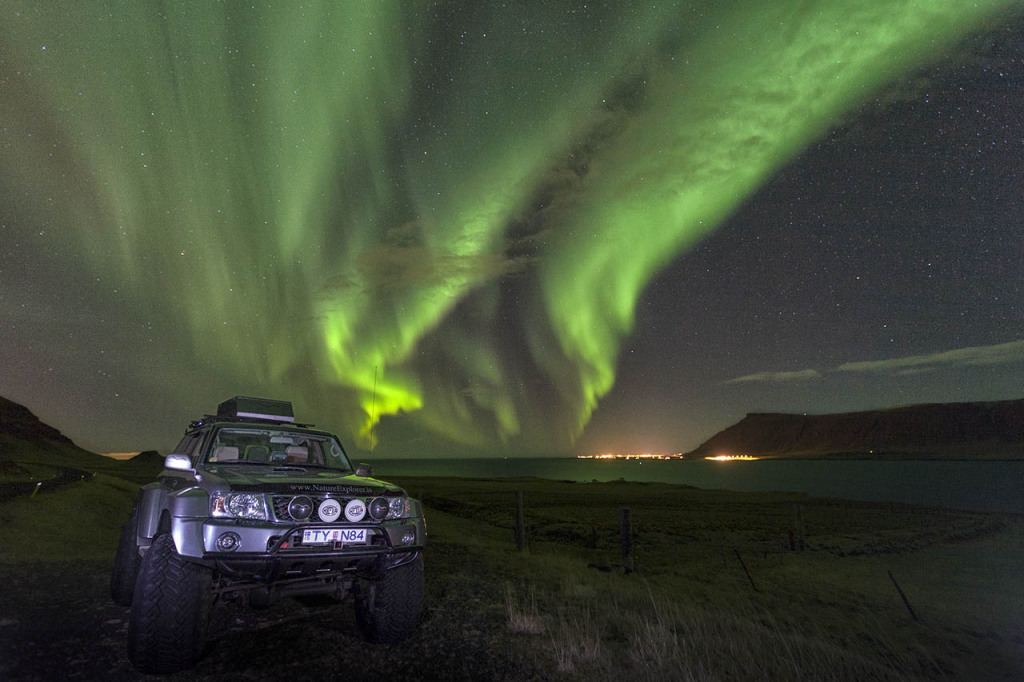 Super-Jeep under the auroras outside Reykjavik