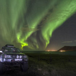Super-Jeep under the auroras outside Reykjavik
