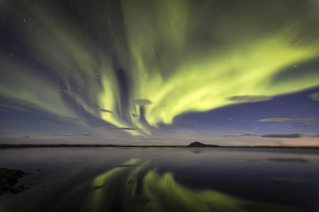 Northern Lights Reflecting In Lake Myvatn Hawk