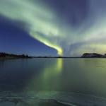 Auroras reflecting in Þingvallavatn lake
